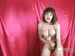 Karla Carrillo shows her big cock on the pink wall