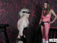 Femdom spanks and tortures blonde sissy with huge strapon