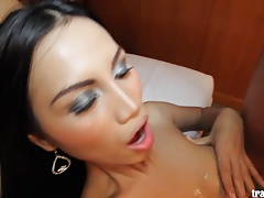 Beauty Asian shemale takes huge cock inside her ass
