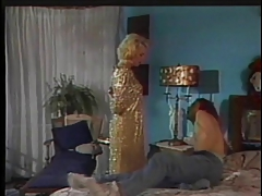 Tranny and a guy in bed playing around