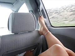 CD lisa riding in van posing legs